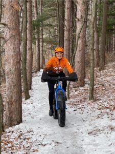 Anne Grofvert Riding Fat Tire Bike on Winter Trail