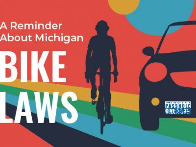 A Reminder About Michigan Bike Laws with Cyclist Passing Car