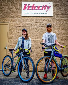 Jill and Matt posing by Velocity sign