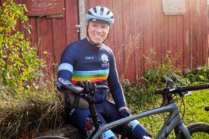 bryan waldman with bicycle by barn