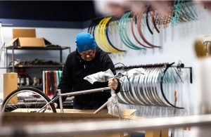 Detroit Bikes employee assembling bike