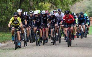 Group of bike riders racing on dirt road